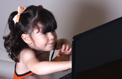 Little-Girl-Computer-Reaching-Kids