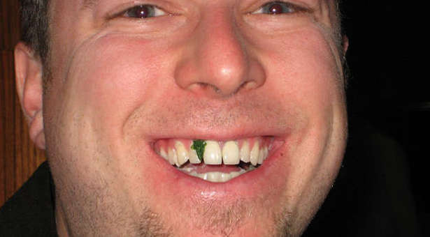 'Wouldn't you tell someone right away if they had spinach caught in their teeth?' from the web at 'http://cdn.ministrytodaymag.com/images/stories/2015/misc/in-teeth-spinach.jpg'