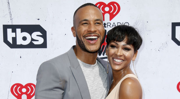 Actress Meagan Good (R) and husband Devon Franklin (L) pose at the 2016 iHeartRadio Music Awards in Inglewood, California, April 3, 2016.